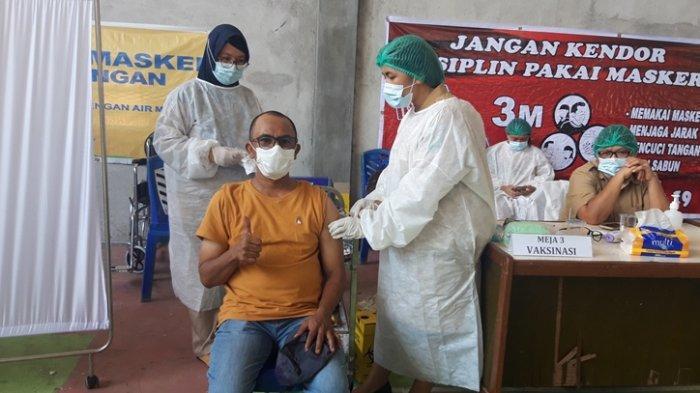 Hasdy Fattah Jadi Wartawan Pertama di Bolmong yang Divaksinasi Covid-19