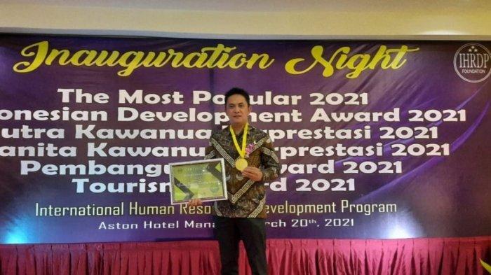 Kepala Desa Pinabetengan Selatan Terima Penghargaan IHRDP