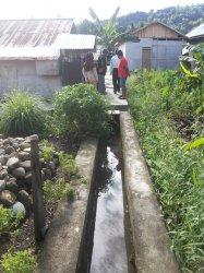 Jalan Desa Buyat Selatan Dibangun Diatas Irigasi Milik Pemprov