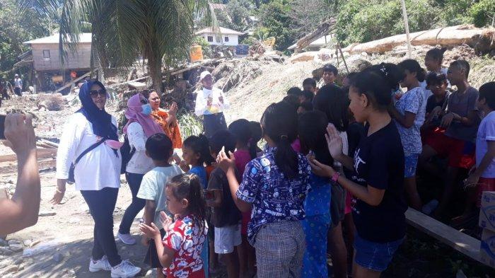 DP3A Bolmong Berikan Trauma Healing Bagi Anak-anak Korban Banjir di Sangtombolang