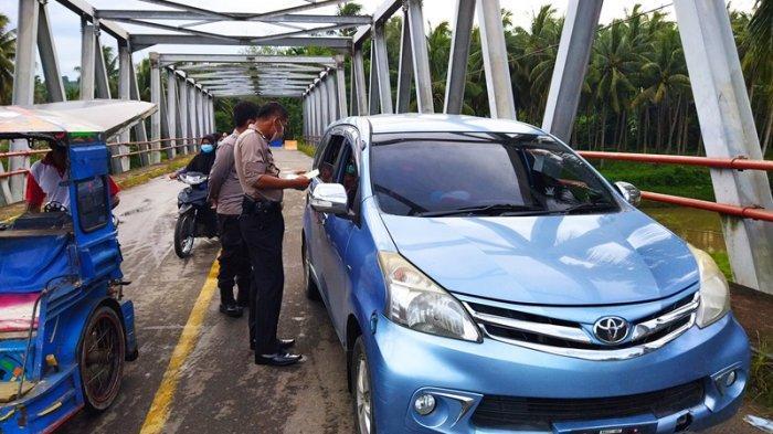 Antisipasi Penularan Covid-19, Kapolsek Pinogaluman Perketat Penjagaan Perbatasan Bolmut-Gorontalo