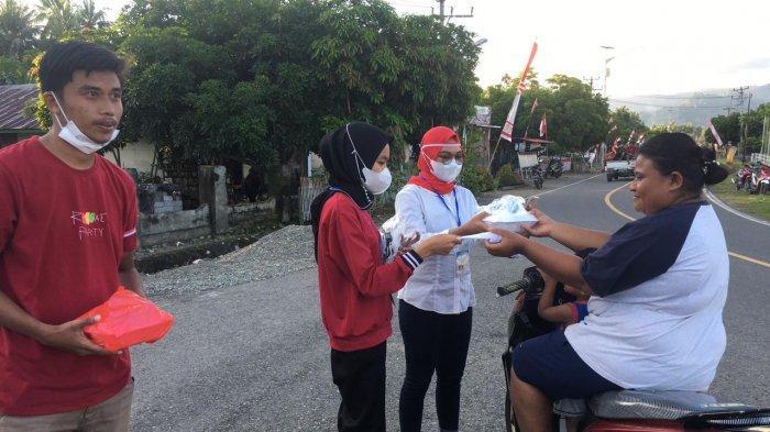 3 Organisasi di Tolondadu Bolsel Rayakan HUT Kemerdekaan RI Ke-76 dengan Berbagi Masker Gratis