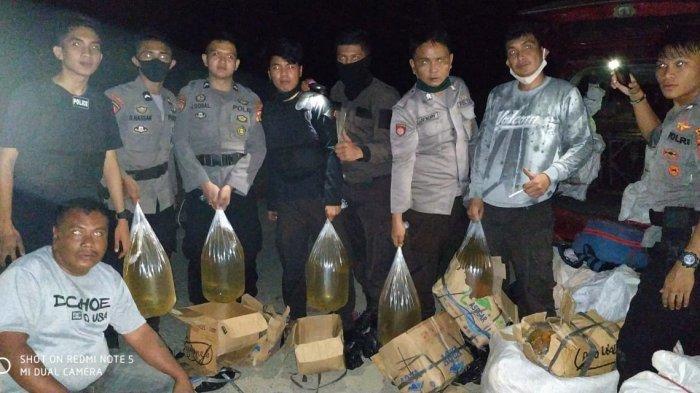 Polres Bolmut Amankan Ratusan Liter Minuman Keras di Jalan Trans Sulawesi