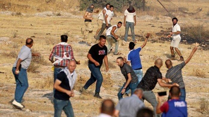 Kerusuhan antara Warga <a href='https://manado.tribunnews.com/tag/israel' title='Israel'>Israel</a> dan <a href='https://manado.tribunnews.com/tag/palestina' title='Palestina'>Palestina</a>, Ratusan Orang Jadi Korban.