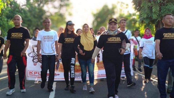 Tingkatkan Partisipasi Masyarakat, KPU Bolmong Gelar Pemilu Run dan Konser Musik //