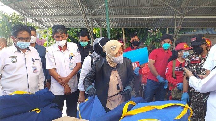 Mensos Risma Keliling Lokasi Bencana di Manado, Usul Bangun Pintu Air di Sungai Tondano dan Rusun