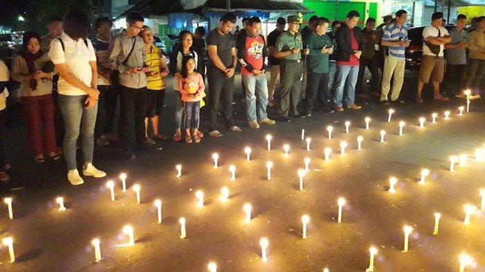 Duka Bakan, Ratusan Lilin Terpasang di Bawah Tugu Perjuangan Kotamobagu