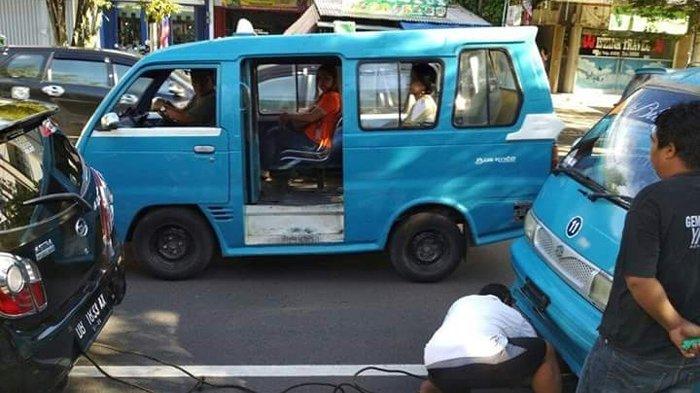 Driver Online di Manado Bantu Derek Mobil Angkutan Konvensional