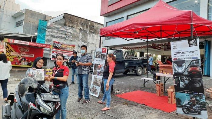 Tridjaya Motor Paal II Bagikan Ratusan Paket Takjil Untuk Masyarakat Manado