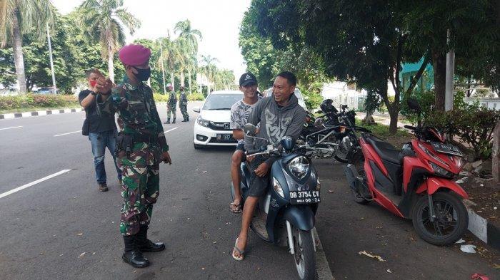 Puluhan Personel Marinir Bitung Turun ke Jalan, Ini yang Dilakukan