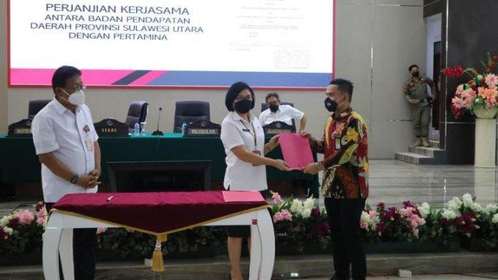 Penandatanganan Kesepakatan Bersama dan Perjanjian Kerja Sama Rekonsiliasi Data PBBKB yang dilangsungkan pada Rabu (16/6) di Kantor Gubernur Sulawesi Utara.