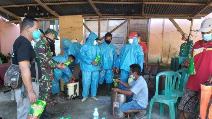 Tekan Penyebaran Covid-19 Pemerintah Kecamatan Passi Barat Bolmong Semprot Disinfektan