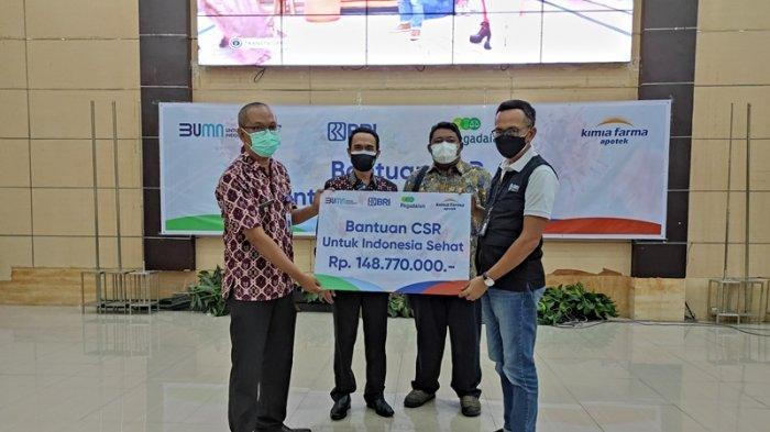 BRI Manado dan Kimia FarmaSerahkan CSR untuk Nakes Sulut