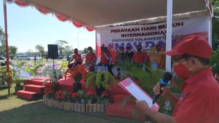 Peringatan May Day, Buruh di Sulut Bersih Pantai dan Bagi-Bagi Sembako