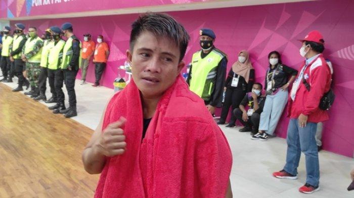 Petinju putri Sulut, Veronica Nicolaas lolos ke semifinal kelas 54 kg setelah menang angka atas Serlin AL Kase (NTT) di GOR Cendrawasih, Jayapura, Papua, Kamis (07/10/2021).