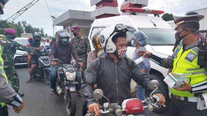 Polres Kota Bitung, Sulawesi Utara memperketat penjagaan di pintu masuk guna mencegah makin menyebarnya virus corona.