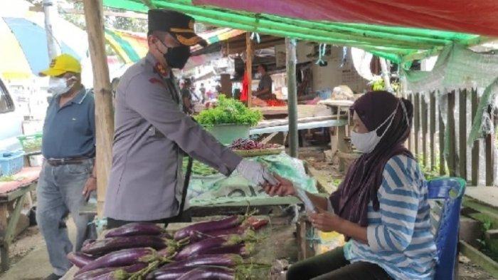 Polres Minut Bagi-bagi Masker dan Imbau Warga Taat Protokol Kesehatan