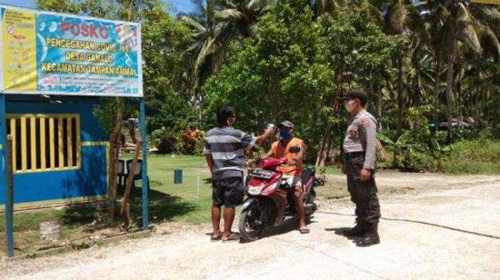 Polsek Rainis Pantau Pelaku Perjalanan di Kecamatan Tampan'amma dan Pulutan