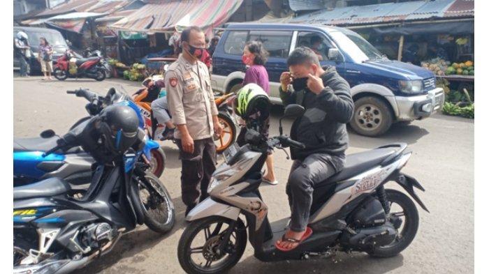 Polisi Tegur Warga Tak Pakai Masker di Pasar Tondano