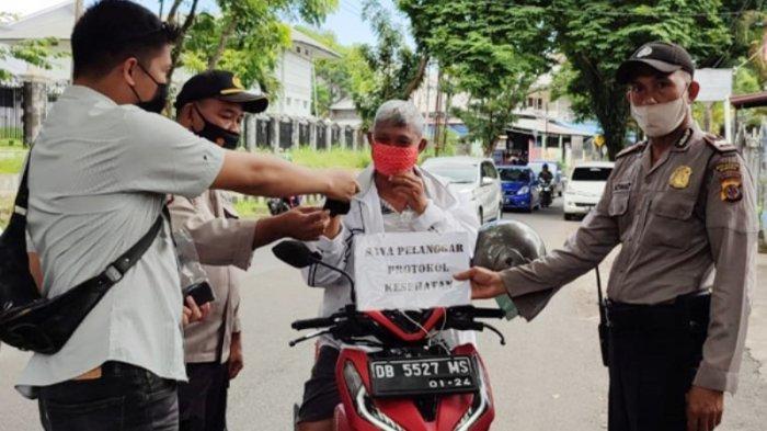 Polsek Wanea & Tuminting Manado Terus Laksanakan Operasi Yustisi, Bagikan Masker di Beberapa Lokasi