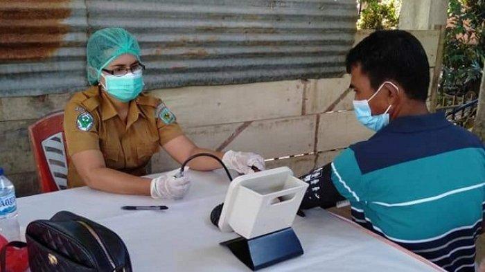 48 Warga Nonapan Satu Terima Vaksin Tahap Dua dari Pemkab Bolmong