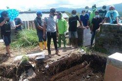 Minut - 600 Makam di Desa Kawangkoan Baru Dipindahkan, Ada Kakek Tertawa Berseri-seri