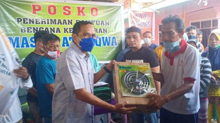 Anggota DPRD Bitung Ramlan Ifram Apresiasi BSM yang Bantu Penyintas Kebakaran Pasar Tua