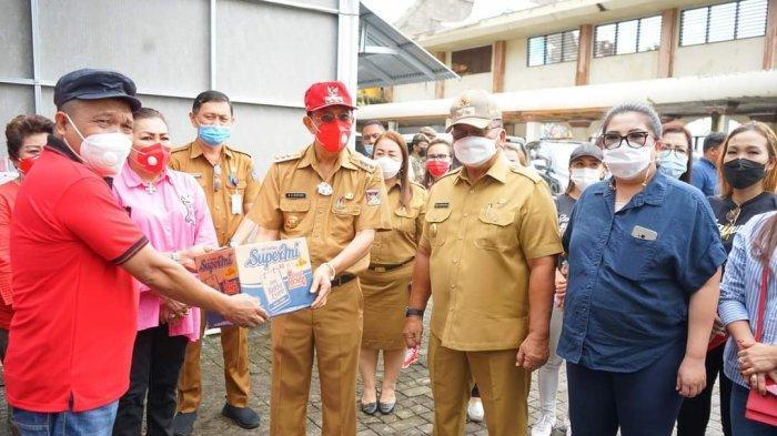 ROR-RD Salurkan Bantuan kepada Korban Banjir di Kota Manado