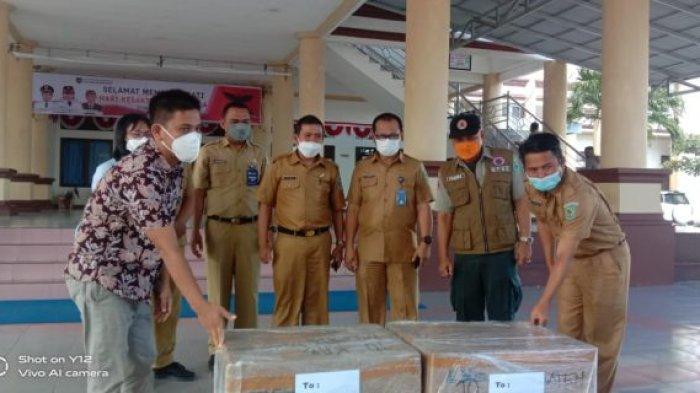 Sekda Bolmong Terima Bantuan 10.000 Masker N95 dari PT MES