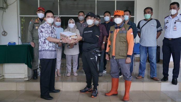 Sekdakot Kotamobagu Antar Bantuan Bencana Alam untuk Masyarakat Manado