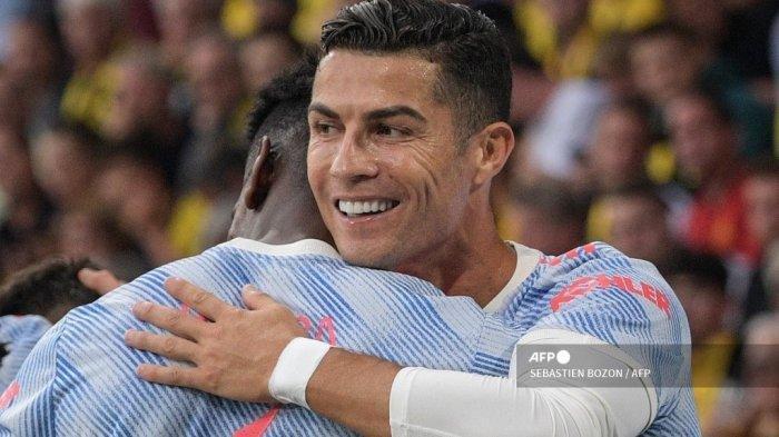 Striker Manchester United Portugal Cristiano Ronaldo merayakan setelah mencetak gol selama pertandingan sepak bola Grup F Liga Champions UEFA antara Young Boys dan Manchester United di stadion Wankdorf di Bern, pada 14 September 2021.