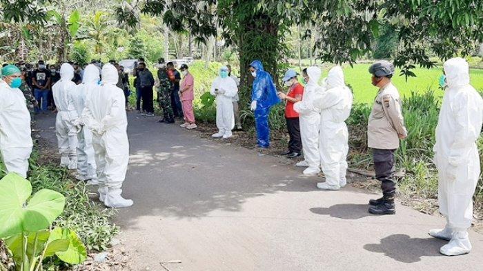 Polsek Touluaan Mitra Kawal Proses Pemakaman Jenazah Covid-19