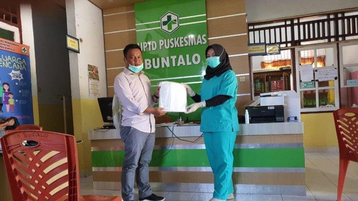 Sulhan Serahkan Bantuan APD dari CEP ke Tenaga Medis Bolmong