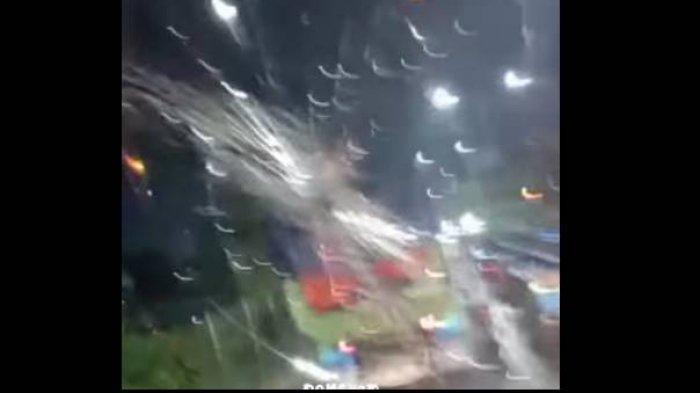 Tangkapan layar video yang memperlihatkan kaca bagian depan truk pecah.