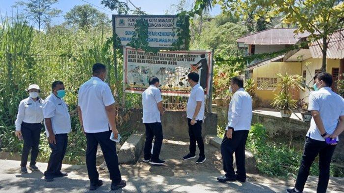 Intip Kerja Wali Kota Andrei Angouw, 'Ngantor' dan Liburan di Selokan Demi Atasi Banjir Manado