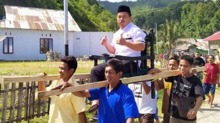 Menang di Pilsang Luwoo Bolsel, Pahrin Kamaru Diarak Masyarakat ke Kantor Desa
