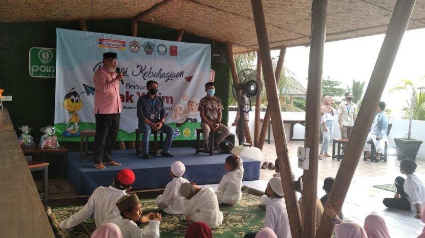 indomaret-bersama-muslim-riders-indonesia-mri-gelar-buka-puasa-bersama-anak-yatim.jpg