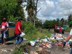 armada-pdi-perjuangan-bersihkan-sampah-di-kabupaten-minahasa-utara.jpg