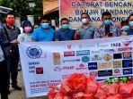 asosiasi-sales-nasional-indonesia-asni-manado-saat-mrmbawa-bantuan.jpg