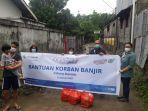 bantuan-untuk-korban-banjir-di-paal-dua-manado-dari-fifgroup-manado.jpg