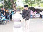 bawaslu-sulut-dan-remaja-masjid-tutuyan-bagi-1000-paket-takjil.jpg