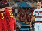 cristiano-ronaldo-bereaksi-ketika-para-pemain-belgia-merayakan-kemenangan-atas-portugal.jpg