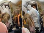 dua-penumpang-pesawat-positif-covid-19-dijemput-petugas-dengan-alat-pelindung-diri-jas-hazmat.jpg