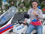 glenda-lapian-salah-satu-anggota-kepolisian-daerah-sulawesi-utarabmnbvnbvn.jpg