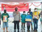 kapolda-sulawesi-utara-irjen-pol-nana-sudjana-beri-bantuan-sosial-di-tpa-sumompo-cdscfsf.jpg