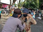 kapolres-saat-membagikan-masker-secara-gratis-pada-masyarakat-di-pasar-airmadidi.jpg