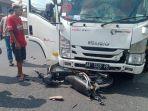 kecelakaan-lalu-lintas-antara-sepeda-motor-dengan-truk-yang-terjadi-di-jalan-magelang.jpg
