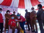 kejati-sulawesi-utara-bekerjasama-dengan-pemerintah-kota-bitung-melaksanakan-pelayanan-vaksinasi.jpg