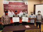 kepala-bpjamsostek-manado-hendrayanto-menandatangani-perjanjian-kerja-sama.jpg
