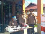 kepolisian-daerah-polda-sulawesi-utara-sulut-menggelar-rapid-test-dengan-drive-thru.jpg